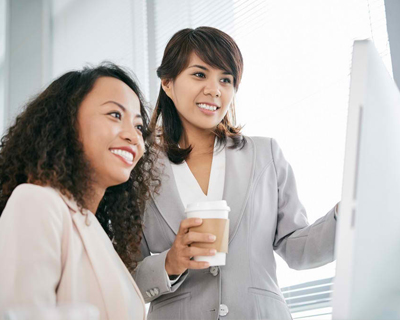two businesspersons looking at the computer
