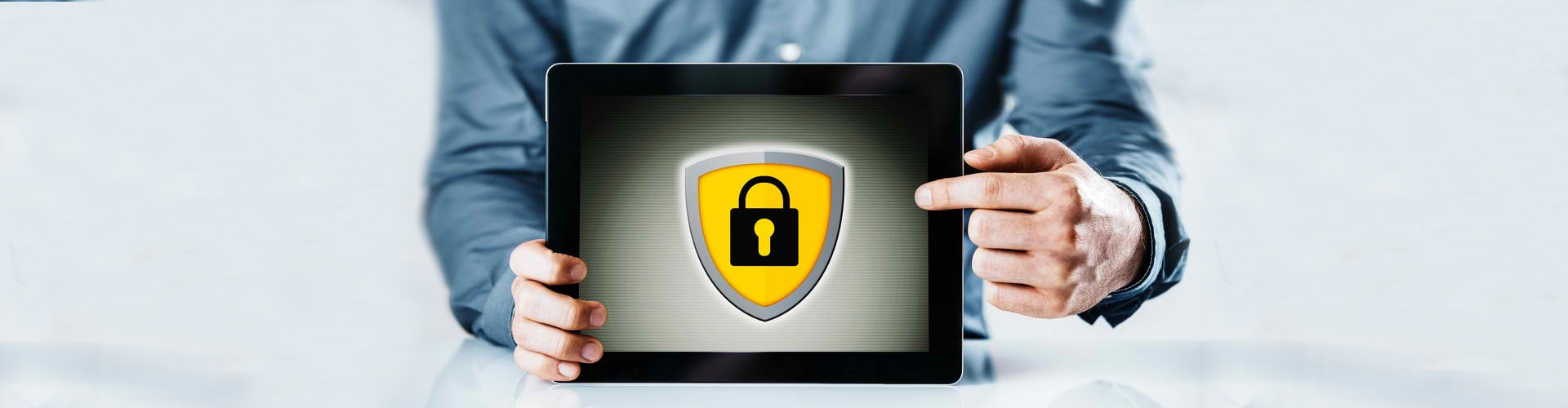 a person holding a tablet that is showing a lock image